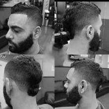 Mann mit BART und faux hawk-fade-Haarschnitt -