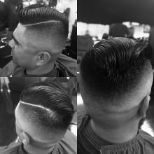 beliebten Herren-Kamm über mit fade Haarschnitt Aussehen
