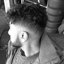 classy low curly fade Jungs Frisur Ideen