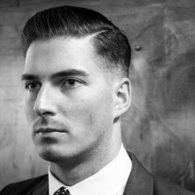 classy professional mid taper fade haircut Männer