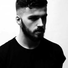 dapper-medium curly fade Herren Haarschnitt