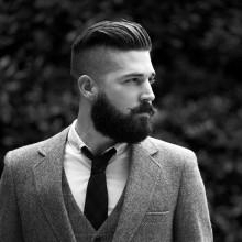 fade Haarschnitt mit BART für Männer