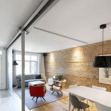Renovierung Bürgerlichen Lechasseur Architekten offener Wohnbereich Wohnzimmer ziegelwand